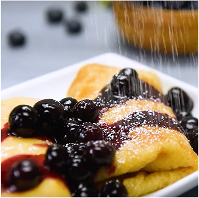 Vegan tofu blintzes with blueberry sauce
